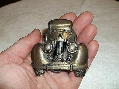 vintage car belt buckle pretty heavy not sure if its made out of brass