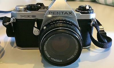 Asahi Pentax KM SLR camera x2 (55mm, 50mm and 28mm additional lens) with cases