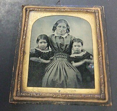 1850s BRITISH AMBROTYPE OF WOMAN, TWO GIRLS, A DOLL AND FLOWERS