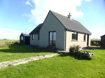 Island home - 3 bedroomed detached house with 1/2 acre garden next to the sea