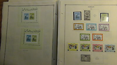 Jordan  stamp collection on Scott International pages / loose to '80 or so