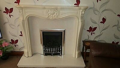 marble effect fireplace. Marble back and hearth and gas fire