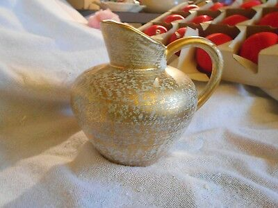 Small Stangl Hand Painted Pitcher in Antique gold.. 4059