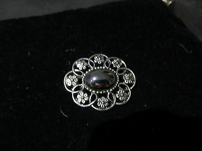 Silver toned Forget Me Not Brooch with glass stone