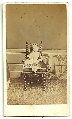 Victorian cdv photo  small girl sitting on chair holding doll