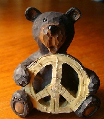BLACK BEAR SITTING PEACE SYMBOL SIGN Lodge Faux Wood Carved Cabin Decor Figurine
