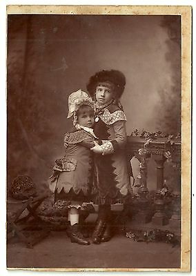 Victorian cabinet card two children embracing unstated photographer