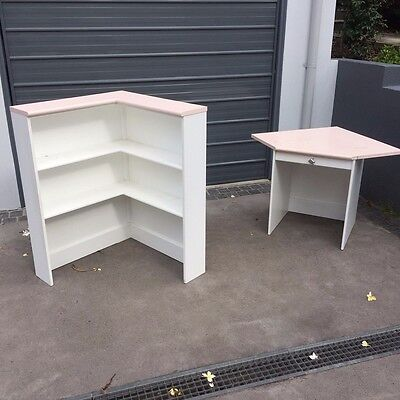 Pink and white girls desk and shelves