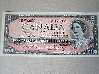A Canadian UNC $2 dollar Banknote issued in 1954.