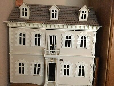 Dolls house complete with all furnishings.