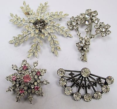 Four large vintage silver metal & diamond paste set brooches