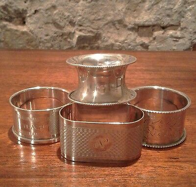 Four English sterling silver napkin rings, dates from 1910 to 1934. weight 67.8g