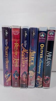 Walt Disney Lot of 6 VHS Tape Movies Black Diamond Beauty Alice Aladdin Mulan