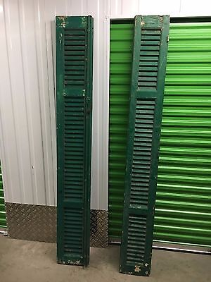 Vintage wooden french shutters, rustic green