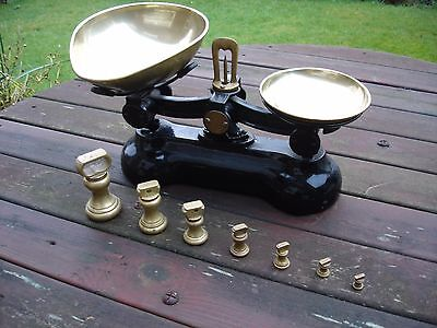 Cast Iron balance scales with set of Brass weights.