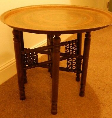 Vintage Moroccan brass table with folding wooden legs