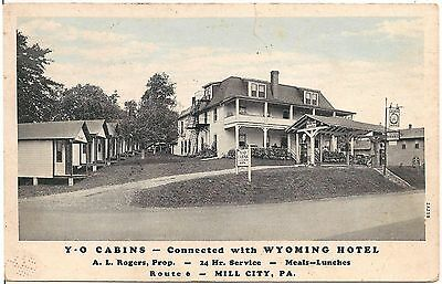 Y-O Cabins Connected with Wyoming Hotel in Mill City PA Postcard Gas Pumps