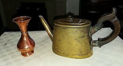 antique brass kettle with wooden handle and copper vase