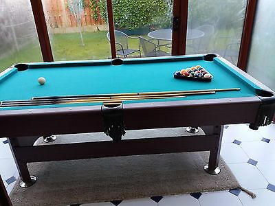pool /snooker table , 7 Ft with various cues and pool ball set.