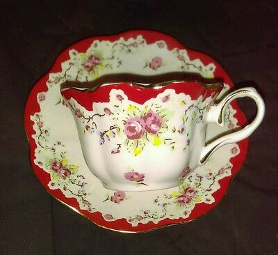 Rose pattern tea cup and saucer, fine bone china, made in England? Vintage