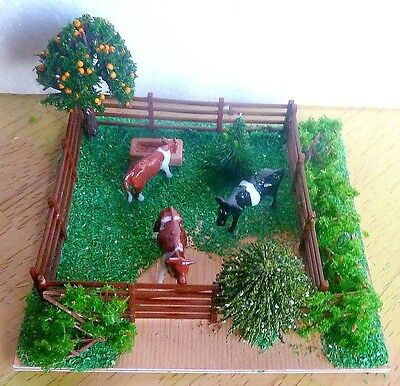 OO gauge   cows om field  scenery diorama for model train layout.