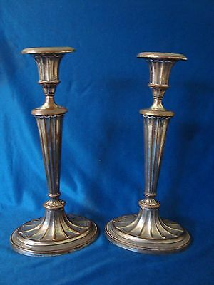 A Pair Of Antique Silver On Copper Tall Candlesticks.