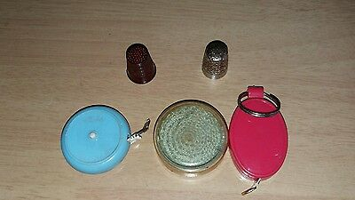 selection of measuring tapes and thimbles