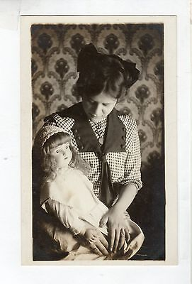 V980 Real Photo postcard Girl with Bisque Doll modt likely German doll