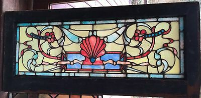 Antique Victorian stained glass transom window with shell motif
