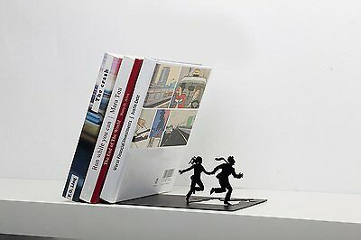 """AD105 - """"Runaway Bookend"""" - Falling books on a running couple - Black Metal"""