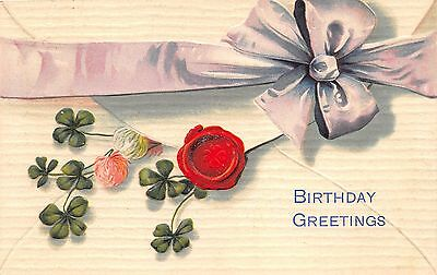 Birthday Greetings~Large Ribbon on Envelope~Seal~Clovers Stick Out~1909 Embossed