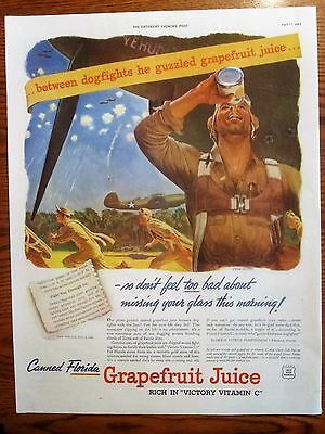 Pilot between Dog Fights Guzzles Grapefruit Juice WWII Ad