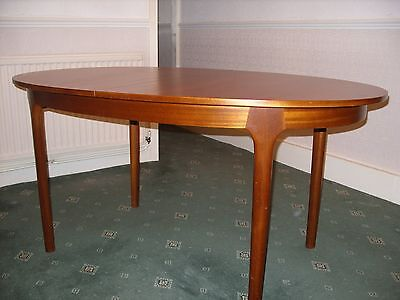 McIntosh vintage 70's extending oval teak table and 6 chairs