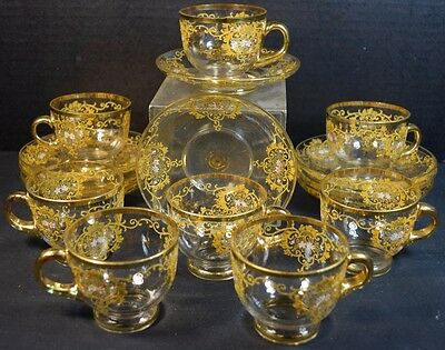 Eight Moser Gilt and Enameled Glass Cups and Saucers