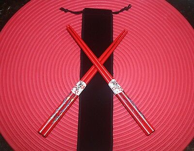 2 pairs of chopsticks - red with blue dragons - in black drawstring bag