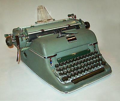 Old antique vtg 1940s Olympia SG1 Typewriter manual special keys works great