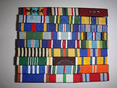 Group Of 27 US Military Ribbon Bars Mounted On A Metal Rack With Pin Backs