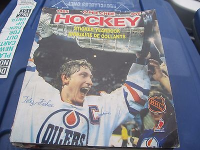 a collection of 8 nhl sticker albums from the 80's and 90's  FREE SHIPPING