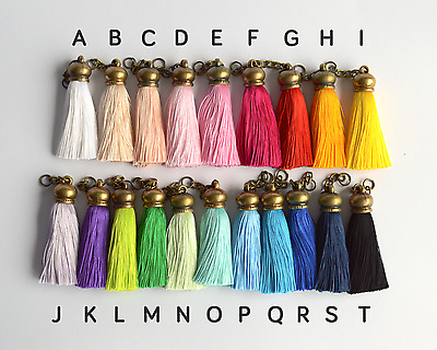 Tassels of many colors with bronze colored top and short chain for purses, craft