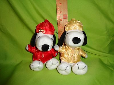 PEANUTS TWO SNOOPY IN CHINESE OUTFITS RED AND YELLOW plush stuffed animal toy