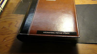 Portugal stamp collection in 3 ring leather binder with stock sheets and recent