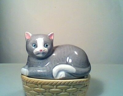 Vintage ceramic candy dish, covered with grey cat lid, on basket. small