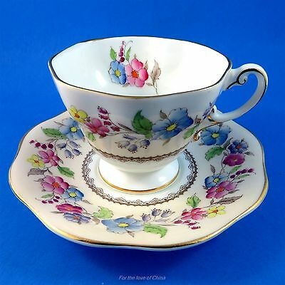 Beautiful Floral Garland On Peach Foley Cup and Saucer