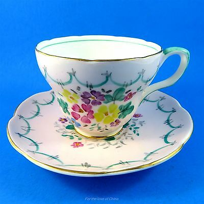 Handpainted Florals on Pink Foley Tea Cup and Saucer Set