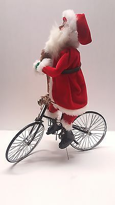 Byers Choice Santa Claus with bag of toys and Bicycle