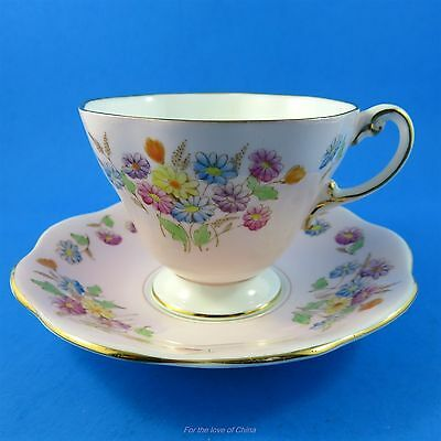 Handpainted Floral Bouquet on Pink Foley Tea Cup and Saucer Set