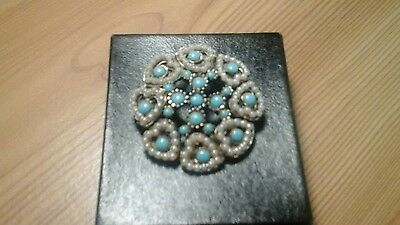 A beautiful vintage costume jewellery brooch with heart shaped design