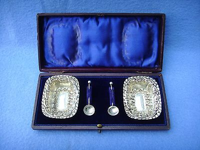 A Fine English Boxed Solid Silver Pair Of Salt's And Spoons.
