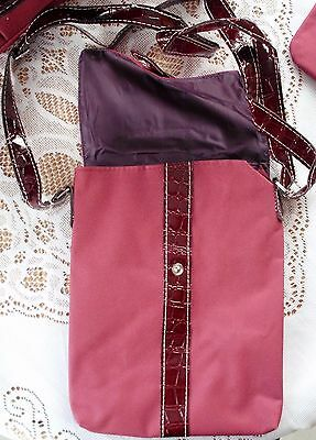 A Brand New Overnight 3 Bag Set In A Waterproof Burgandy.