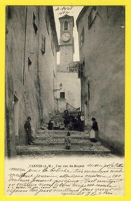 cpa 06 - France CANNES en 1904 (Alpes Maritimes) Une Rue du SUQUET Animés Cloche